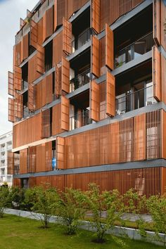 Wilanowska Apartments by Jems Architects, Warsawm Poland. movable wooden louvers are provided to a substantial part of the facades, which, alternately open or closed, form a delicate, vibrating structure.