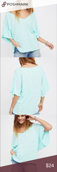Free People boyfriend tee New with tags. Size small but fits oversized Free People Tops Tees - Short Sleeve