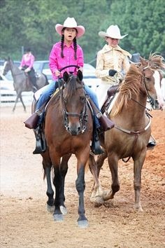 loved the expression on the little girls face...come to find out that this was her first ride in a horse show..was in fentress county tn...