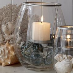 """Clearly Creative Pillar Hurricane  Unique design uses a metal candle hanger to suspend a pillar candle, sold separately, in a vessel of hand-blown glass. Add your own seasonal decorations to create a custom display. 10 1/2""""h, 9""""dia.  http://www.partylite.biz/sites/jjcorkum"""