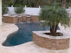 Renovated pool to add a stacked stone spa, planter, & travertine decking.