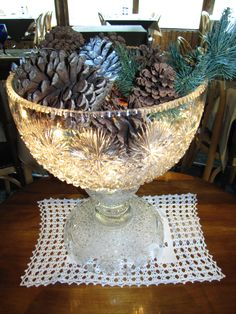 This is a great way to show off a punch bowl that you don't use very often...just fill it with Christmas light strands and decorate on top! Lynne Ludwig, the owner of The Rapids Lodge, put this one together.