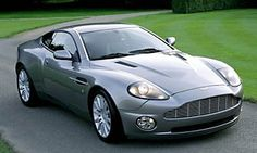 Aston Martin Vanquish...if I ever win the lottery I'd buy this for JJ in a heartbeat...lol
