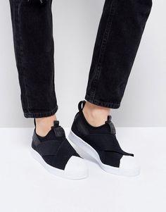 ¡Consigue este tipo de deportivas de Adidas ahora! Haz clic para ver los detalles. Envíos gratis a toda España. Zapatillas de deporte sin cierres Black Superstar de adidas Originals: Zapatillas de deporte de Adidas, Exterior de tela, Diseño sin cierres, Detalle de tiras cruzadas, Borde con forma de calcetín, Logo de adidas Originals, Puntera de goma de la marca, Suela en contraste, Dibujo moldeado, Limpiar con un paño húmedo. Fundada hace 60 años, Adidas es una de las marcas de moda u...