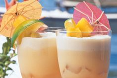Tropical Rum Cocktail - 1 oz white rum, 1 oz dark rum, 1 oz kahlua, 1 tsp fresh lemon juice,  2 tsps orange juice, slice lime--Vigorously shake the white rum, dark rum, Kahlua, lemon juice and orange juice over ice cubes in a shaker until well frosted. -2 Strain into a chilled lowball glass. (I poured it with the ice). -3 Decorate with the slice of lime.
