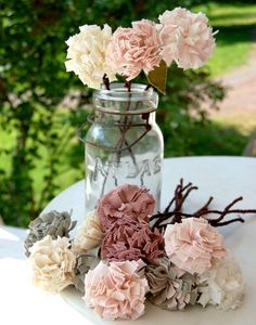 Fabric flower centerpiece in vintage pinks and grays.