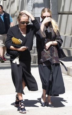 Olsens Anonymous Blog Mary Kate Ashley Olsen New York City The Row Looks Patchwork Embroidered Jacket Midi Black Dress Small Croc Tote Bag Bottega Veneta Kitten Heels V Neck Sweater Suede Clutch Bag Midi Skirt Christian Louboutin Nymphette Satin Lace-Up Sandals Low Buns Ponytail The Row Skirts Dresses 2014 photo Olsens-Anonymous-Blog-Mary-Kate-Ashley-Olsen-New-York-City-The-Row-Skirts-Dresses-Christian-Louboutin-Sandals-2014.jpg