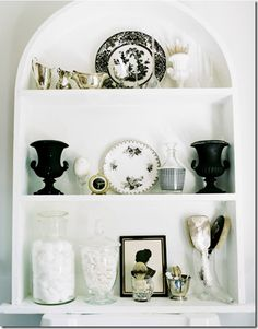 great use of black with mainly white. I have black urn vases just like these!