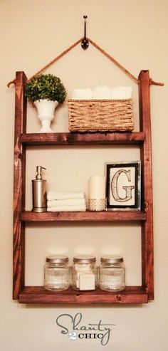 A $10 Shelf for bathroom storage that is simply made with 2x4' s and a piece of rope! Finish with your choice of stain as shown here or paint it a ocean color for nautical decor!