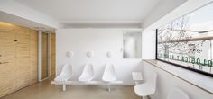 Image 6 of 9 from gallery of Dental Clinic in Torrelles / Sergi Pons. Photograph by Adrià Goula Clinic Interior Design, Clinic Design, Healthcare Design, Dental Reception, Reception Areas, Store Signage, Dental Design, Spa Center, Chairs