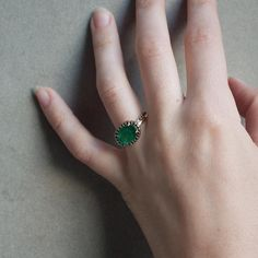 The emerald & black diamond Delilah Ring by Liz Phillips.