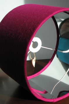 A stylish, contemporary combination of cerise pink Harris Tweed and mirror silver lining.