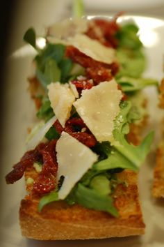 One of my favorite sandwich's from Ina Garten. Caesar club sandwich. Chicken, sun dried tomatoes, pancetta, parmesan cheese and arugula on Ciabatta bread. YUMMY!