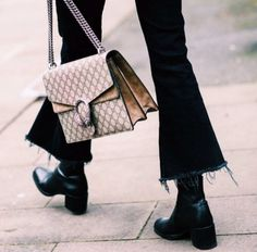 Flare frayed jeans worn with pointed toe ankle boots and lust-worthy Gucci handbag