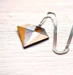 """Cheap Diamond Diy Geometric """"Diamond"""" Necklace - A cheaper way to wear a big diamond! Make this geometric """"diamond"""" necklace in any colors you fancy- a great project for using your scrap pieces of leather or faux leather. Diamond Pendant Necklace, Diy Necklace, Diamond Jewelry, Necklaces, Champagne Diamond, Diamond Shapes, Gifts For Friends, Diy Jewelry, Big"""