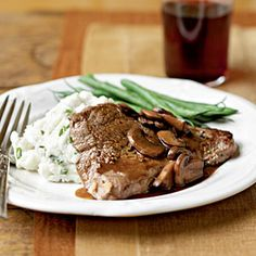 Recipe For Sirloin Steaks with Mushroom Sauce and Chive Garlic Potatoes - It doesnt get heartier than a big piece of steak topped with savory gravy paired with creamy mashed potatoes. And our version manages to keep calories in check: The whole Potato Recipes, Meat Recipes, Cooking Recipes, Healthy Recipes, Healthy Foods, Recipies, Dinner Recipes, Healthy Dinners, Grilling Recipes