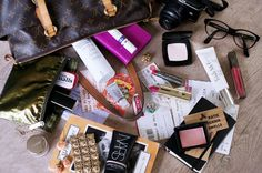 "why am I so obsessed with these ""What's in My Handbag""?!  haha"