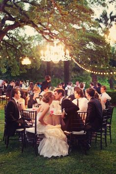 Outdoor chandelier id love bride n groom at their own table. N a table for bridesmaids n same for groomsmen. My dream wedding is outdoor!