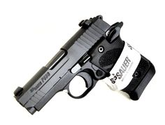 """Sig Sauer P938 Blackout 9mm. P938-9-MGE12. Sig Sauer's P938 is a compact semi-automatic CCW pistol inspired by the 1911, with the thumb safety, magazine release and slide stop lever in familiar places. This model is a MGE distributor exclusive, and features a lightweight aluminum frame, stainless steel slide, full-size SIGLITE night sights, ambidextrous controls, and a Houge rubber grips. 7+1 capacity of 9mm. 3"""" barrel. 16 oz. [New in Box] $659.99"""