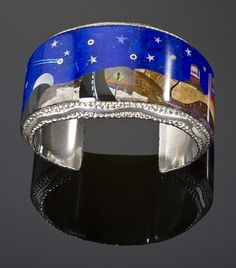 Cuff | Alvin Yellowhorse. 'Monument Valley'.  Sterling silver inlayed with lapis, turquoise and tiger eye.