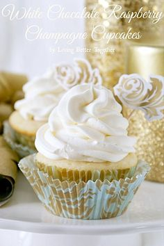 These White Chocolate Raspberry Champagne Cupcakes are a must at your New Year's Eve party! Sweet and fluffy white chocolate cupcakes filled with tart raspberry filling and finished off with a sophisticated champagne frosting!