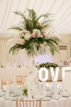 This palm leaf centrepiece from a reception at Hylands House and Grand Pavilion…