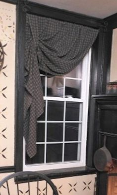 Primitive curtain for kitchen. SEW-SIMPLE ...but very cute...would also be pretty with a lace panel tied up with a ribbon or piece of lace trim around the rod.