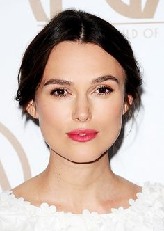 Keira Knightley dons a shimmery, copper-tinged shadow and a rosy pink lip.