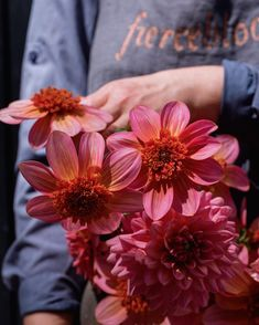 Its a totally tangerine sort of Sunday.  .  . The sun is shining (in fact its a scorcher) and this weekend we are having a slight staycation.  . . .But its dahlia season and I still had to cut these Totally Tangerine  and Salmon Runner dahlias which are growing their socks off in the cutting garden and nodding in the gentle summer breeze. These eye poppers  theme perfectly with the blue sky - and my blue apron come to that.  . . . What are you doing with yourself this beautiful August… Blue Apron, Summer Breeze, Dahlias, Staycation, Garden Styles, Sorting, Salmon, Sunshine, Sunday
