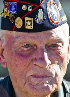 The face of William Eldridge, a former machine gunner with the U.S. Army 31st Infantry Regiment and survivor of the Bataan Death March, March 24. Eldridge endured marching nearly 80 miles subject to conditions of extreme brutality under the Japanese, who held him along with 76,000 other allied forces members as prisoners of war during World War II. http://www.bataanmarch.com/   (DVIDS photo by Daniel Liddicoet. Used with permission.)