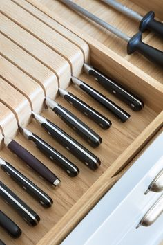 A knife drawer insert keeps knives neat and tidy in one place and off the work surface (which is particularly important with little ones). Often located above the bin on the island (which is usually in the space used as the main food prep area), knives are to hand when preparing food at the island or cooking run opposite. #humphreymunson #knifedrawer #humphreymunsonblog #bespokekitchen