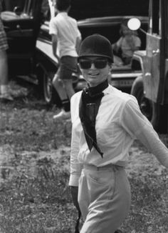 Jacqueline Kennedy Onassis in full riding habit at a horse show.