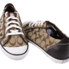 Coach sneakers Used worn a few times. Brown coach sneaker there are wear and tears on the bottom and sole Coach Shoes Sneakers