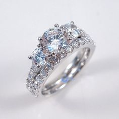 Round Cut Three Stone Solitaire Engagement Wedding Rings Set Silver CZ from Zhannel. Engagement Solitaire, Wedding Rings Solitaire, Dream Engagement Rings, Engagement Wedding Ring Sets, Princess Cut Engagement Rings, Antique Engagement Rings, Bridal Rings, Princess Wedding, Wedding Bands