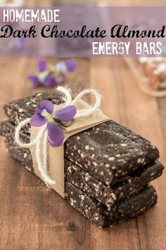 Homemade Dark Chocolate Almond Energy Bars Recipe. Only a few ingredients are used for this healthy energy bar recipe and they are all clean eating friendly. Pin this healthy snack recipe to try later.