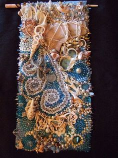 Storm at Sea  by N Chee Latta   Seed beads, shells, driftwood, pressed glass shapes, metal beads and pearls