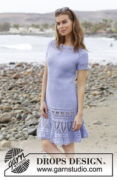 Crocheted dress with raglan, lace pattern and short sleeves, worked top down. Sizes S - XXXL. The piece is worked in DROPS Safran.