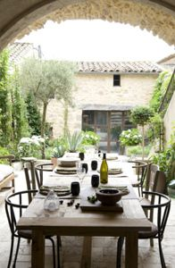 outdoor dining table of renovated country home in Usez, south of France