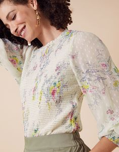This charming blouse is suitable for both work and play. It's crafted from a light, comfortable fabric with a shirred bodice and beautiful floral print.