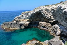 The grotto next to the southern most point. The coast of Puglia is very rocky, the waters crystal clear and colored in varying shades of blue.