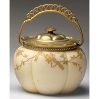 Webb buscuit jar, melon form with enameled gold flowers and leaves against an ivory satin background, gold rim, lid and handle