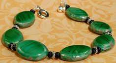 The luxuriously rich green tones of Malachite originally drew the designer to these beautiful Czech glass beads. With the look...