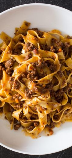 Weeknight Tagliatelle with Bolognese Sauce. In addition to passing grated Parmesan for serving, we stir ½ cup directly into the sauce to take advantage of its umami richness and help get it to the table quicker.