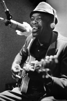 """John Lee Hooker could be said to embody his own genre of the blues, often incorporating boogie-woogie piano figures and a driving rhythm into his guitar playing. His best known songs include """"Boogie Chillen'"""" (1948), """"I'm in the Mood"""" (1951) and """"Boom Boom"""" (1962), the first two reaching #1 on the Billboard R&B chart."""
