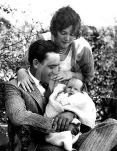 Harold Lloyd and Mildred Davis with their newborn daughter, Gloria