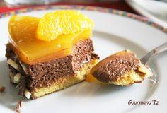 MIROIR ORANGE / CHOCO (BISCUIT : 1/2 c à c d'extrait d'amandes amères, 65 g de poudre d'amandes, 1 c à s d'eau, 2 c à s de sirop d'agave, 2 oeufs, 1 c à s de grand marnier + 2 c,à s de sirop d'agave) (MOUSSE : 15 cl de lait de soja, 150 g de chocolat noir à 65%, 2 c à s de sirop d'agave, 2 oeufs, 15 gouttes d'HE d'orange douce) (GELEE : 20 de jus d'orange pressée, 2 c à s de sirop d'agave, 1 g d'agar-agar en poudre, 4 g d' huile essentielle d'orange douce)