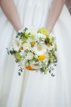 Crespedia, Eucalyptus, Gerbera Daisies, Lisianthus, Ranunculus, Roses and Stock - Love all the white with tiny pops of yellow!