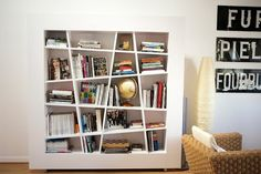 Furniture, The Exuberant White Smart Angled Bookshelf And A Brown Bamboo Chair And A White Wall: Angled Bookshelf For A Book Addicted Man