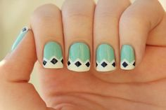 A very relaxing French manicure that plays with white, sea green and black combinations. The nails are coated with sea green as the base, using white as the tip; designed in zigzag shapes. Additional black diamond shapes are then painted on top.