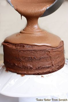 A simple, moist chocolate cake, filled with dark chocolate mousse, and then a warm chocolate frosting poured on top! Chocolate Mousse Cake, Chocolate Desserts, Chocolate Frosting, Chocolate Filling, Chocolate Chocolate, Just Desserts, Delicious Desserts, Yummy Food, Gourmet Desserts